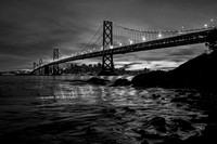 san_francisco_bay_bridge_tide_coming_in_black_and_white